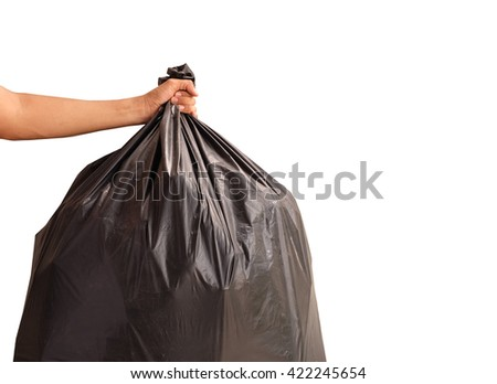 Man hand holding garbage bag isolated on white background - stock photo