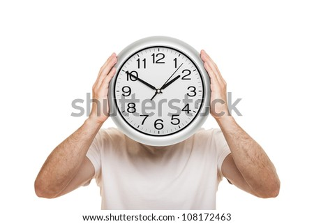 Man hand holding large office wall clock showing time isolated on white