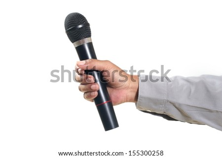 Man hand holding microphone, isolated on white - stock photo