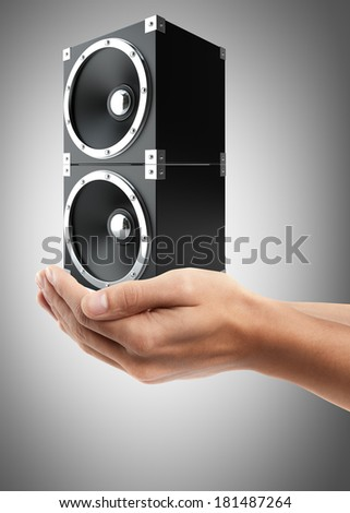 Man hand holding object ( black speakers ) High resolution  - stock photo