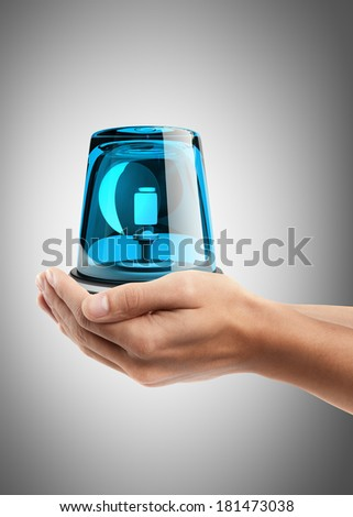 Man hand holding object ( blue siren ) High resolution  - stock photo