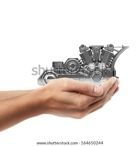 Man hand holding object ( chromed motorcycle engine  )  isolated on white background. High resolution
