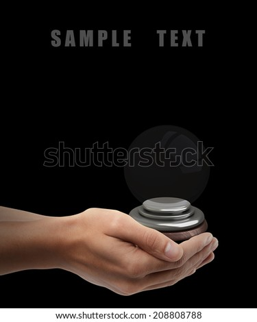 Man hand holding object ( empty crystal ball ) isolated on black background. High resolution  - stock photo