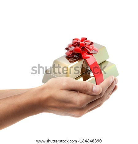 Man hand holding object ( Gold ingots as generous gift with red ribbon and bow )  isolated on white background. High resolution