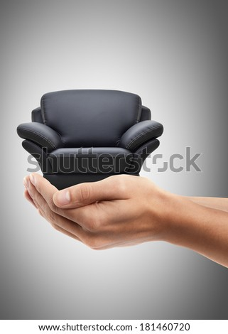 Man hand holding object ( modern leather chair ) High resolution  - stock photo