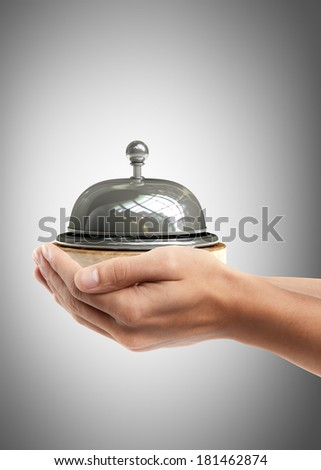Man hand holding object ( Reception bell )  High resolution  - stock photo