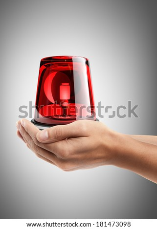 Man hand holding object ( red siren ) High resolution  - stock photo