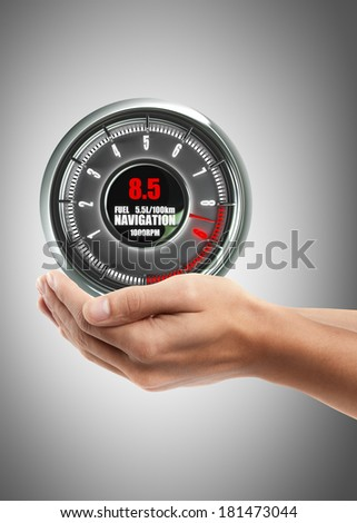 Man hand holding object ( tachometer )  High resolution  - stock photo