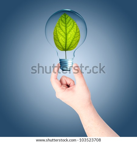 Man hand holding on light bulb with green plant inside. Concept for idea for environmental conservation