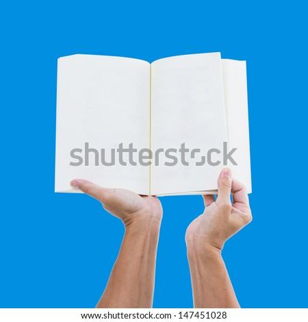 Man hand holding open book on blue screen - stock photo