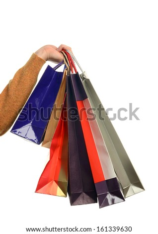 Man hand holding shopping bags. Hand of a man holding many shopping bags. Isolated on white. - stock photo