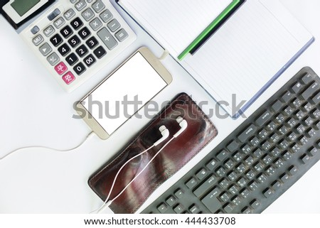 Man hand holding smart phone with white blank empty screen on white desk table.