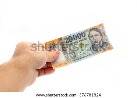 man hand holding the new 20000 forint banknote isolated on white - stock photo