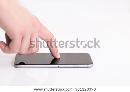 man hand holding the phone tablet touch computer gadget with a touchscreen. Place for your text.