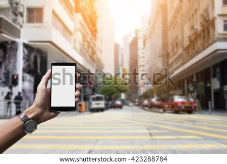 man hand holding the phone with white screen. Smart phone with blank screen and can be add your texts or others on smart phone. - stock photo