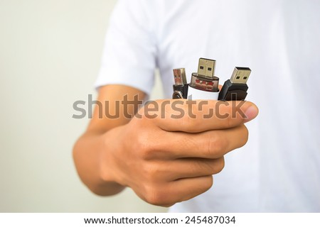 Man hand holding three usb flash - stock photo