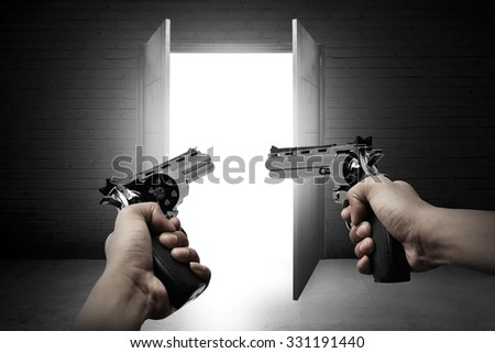 Man hand holding two gun and aim to the door - stock photo
