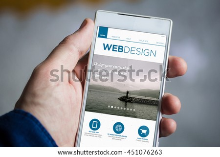 man hand holding web design smartphone. All screen graphics are made up.