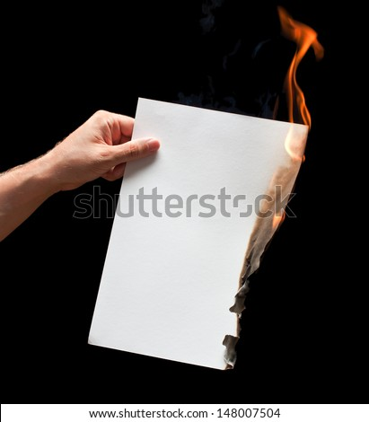 Man hand holding white burned paper - stock photo