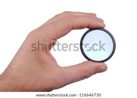 man hand holds a circular polarizer filter, isolated on white background