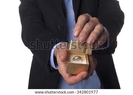 Man Hand in Suit Holding Golden Jewelry Box Isolated on White Background