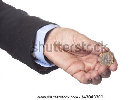 Man Hand in Suit Holding One Euro Coin Isolated on White Background - stock photo