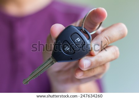 man hand is holding a car key - stock photo