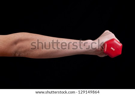 Man hand is holding a red barbell on black background