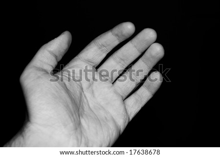 Man hand isolated on black