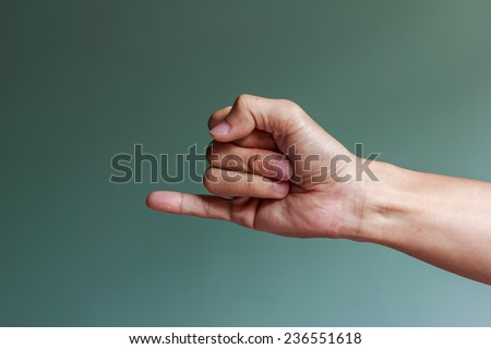 Man hand making a promise,pinky - stock photo