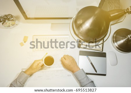 Man hand on computer keyboard on table top view background