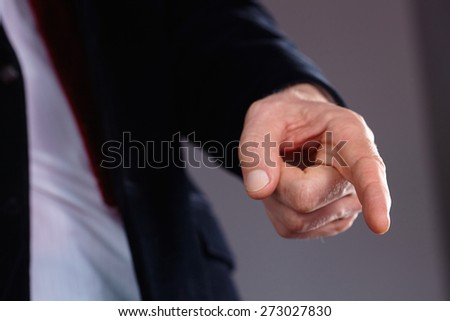 man hand pointing at something - stock photo