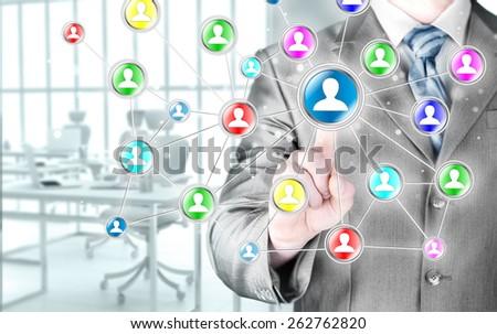 man hand pressing social media icon - stock photo