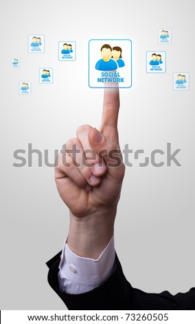 man hand pressing social netowork icon - stock photo