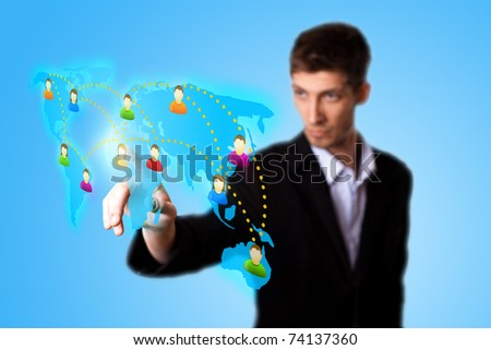 man hand pressing Social network icon. selective focus - stock photo