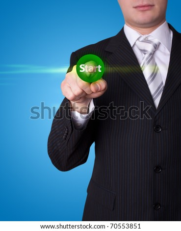Man hand pressing Start button - stock photo