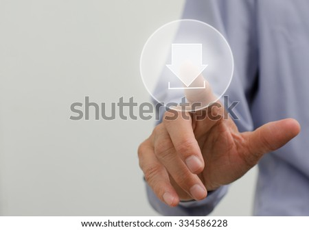 Man hand pushing download icon with virtual screen. - stock photo