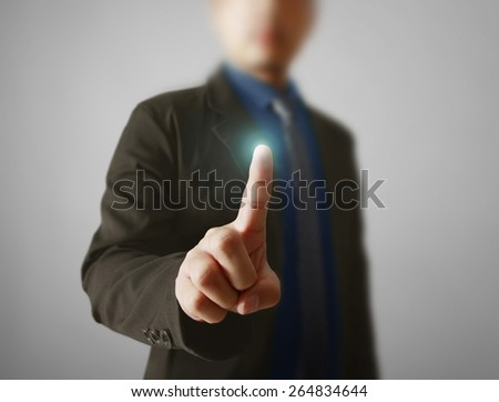 Man hand pushing on a touch screen interface  - stock photo
