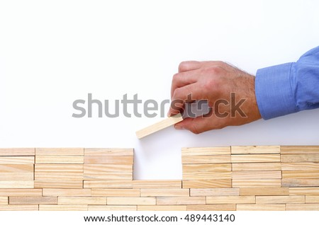 man hand putting brick over the gap between problem and solution, Solutionand creativity concept. top view over white background