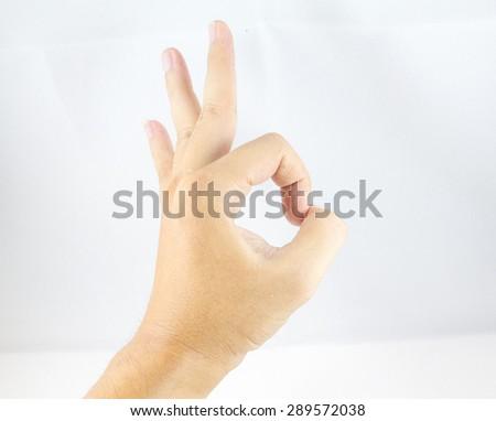 man hand show OK status - stock photo
