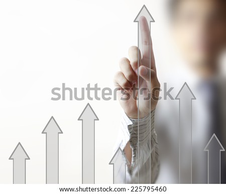 man hand showing graph with financial symbols coming from hand - stock photo