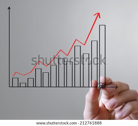 man hand showing graph write with a pen  - stock photo