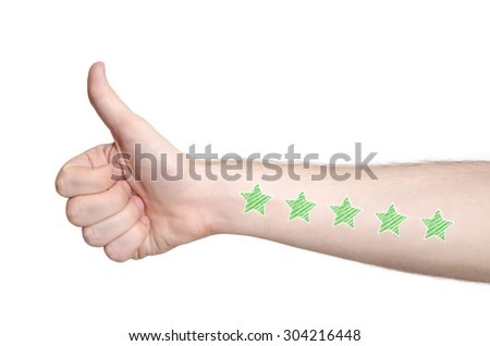 Man hand showing thumbs up and five star rating on the arm skin, isolated white. Like - stock photo