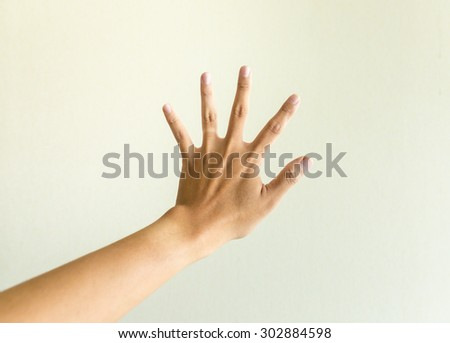 man hand showing two count hand showing five count - stock photo