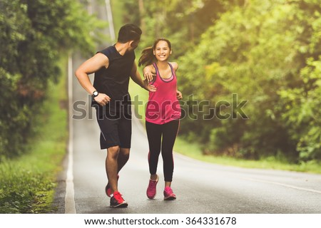 Man hand To help women A highly successful run uphill - stock photo