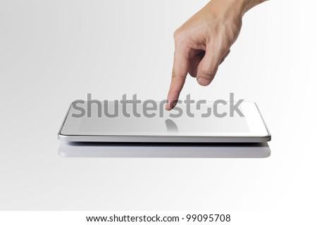 Man hand touching screen on modern digital tablet pc. - stock photo