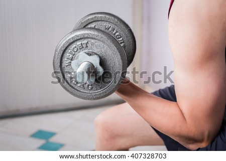 Man hand training lifting dumbbell strong bodybuilding.