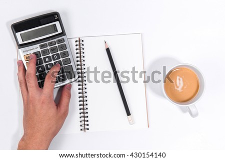 Man hand uses a calculator on white background. Blank Notebook with black pencil on white background. Notebook isolated. Black pencil on white. Top view.