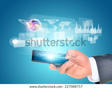 Man hand using smart phone. Earth near phone. Element of this image furnished by NASA