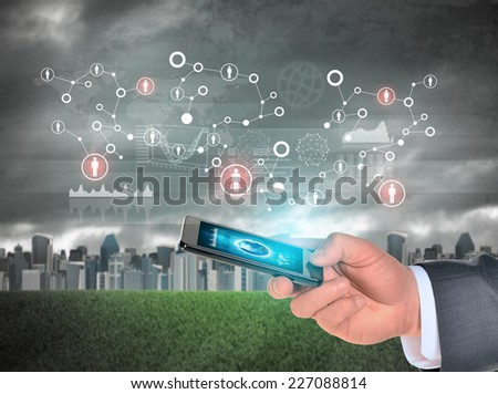 Man hand using smart phone. Earth on phone screen. City as backdrop. Element of this image furnished by NASA - stock photo